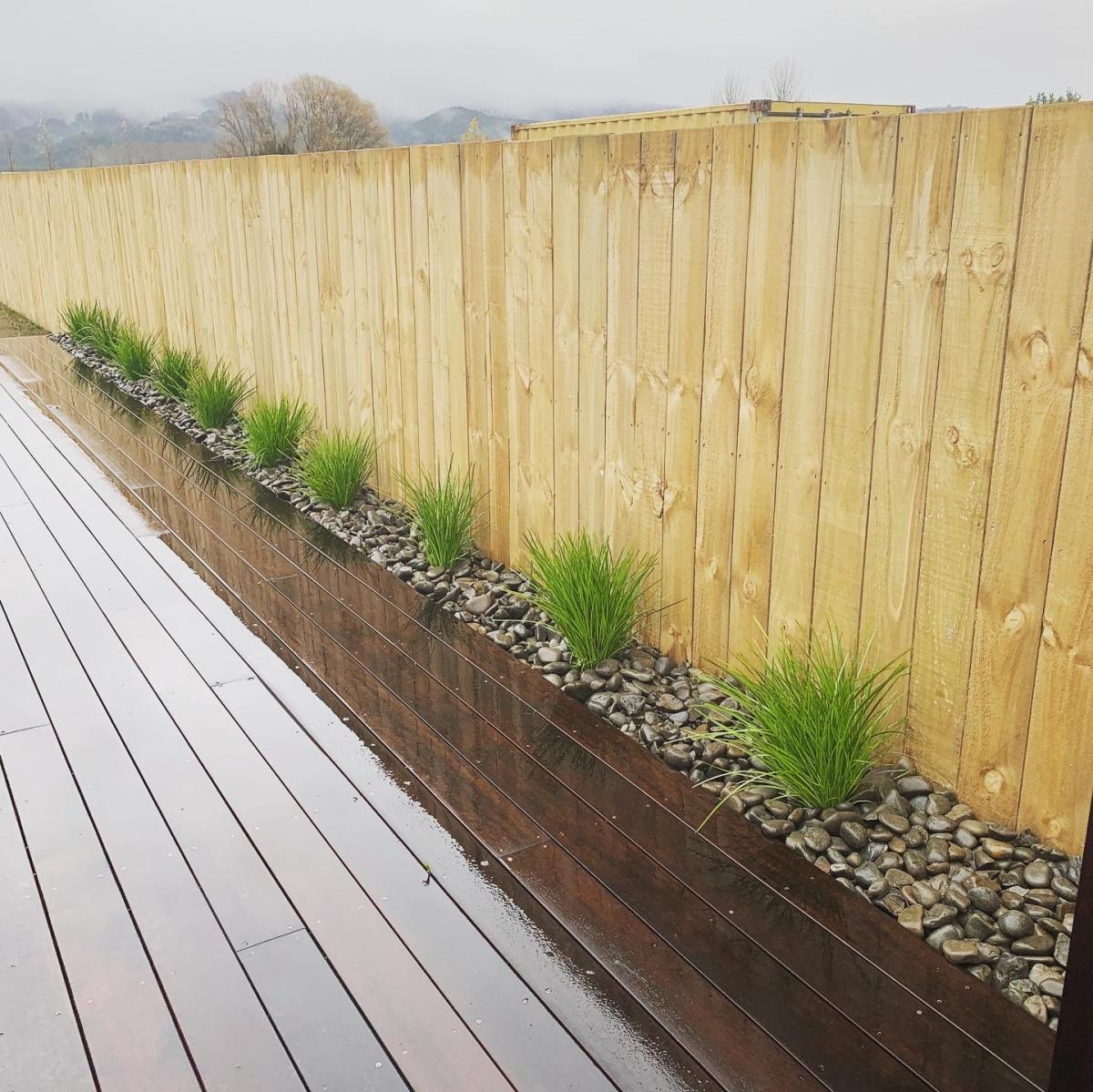 Kupe house fence, deck and landscaping
